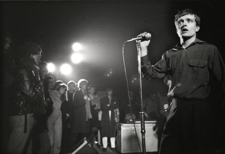 """Singer Ian Curtis on stage in 1980 with Joy Division, whose song """"Transmission"""" is among those explored in Greil Marcus' book <em>The History of Rock 'N' Roll in Ten Songs.</em>"""
