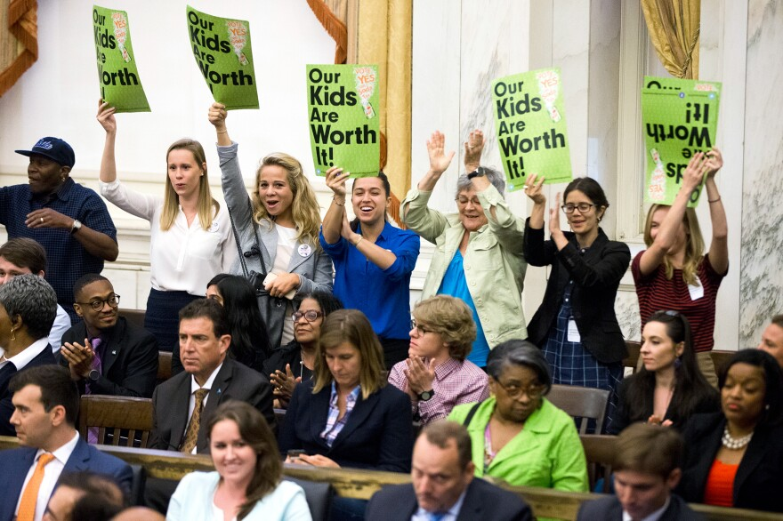 Audience members cheer after Philadelphia City Council passed a tax on sugary and diet beverages.