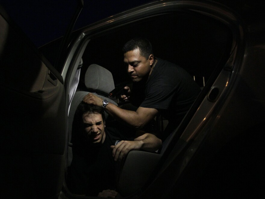 Two men participate in a kidnapping drill in an intensive self-defense course at the School of Personal Protection in Caracas. In 2011, there were 1,150 reported kidnappings in Caracas alone. It's widely believed that the vast majority of kidnappings aren't reported at all — in large part because many victims believe their kidnappers are police.