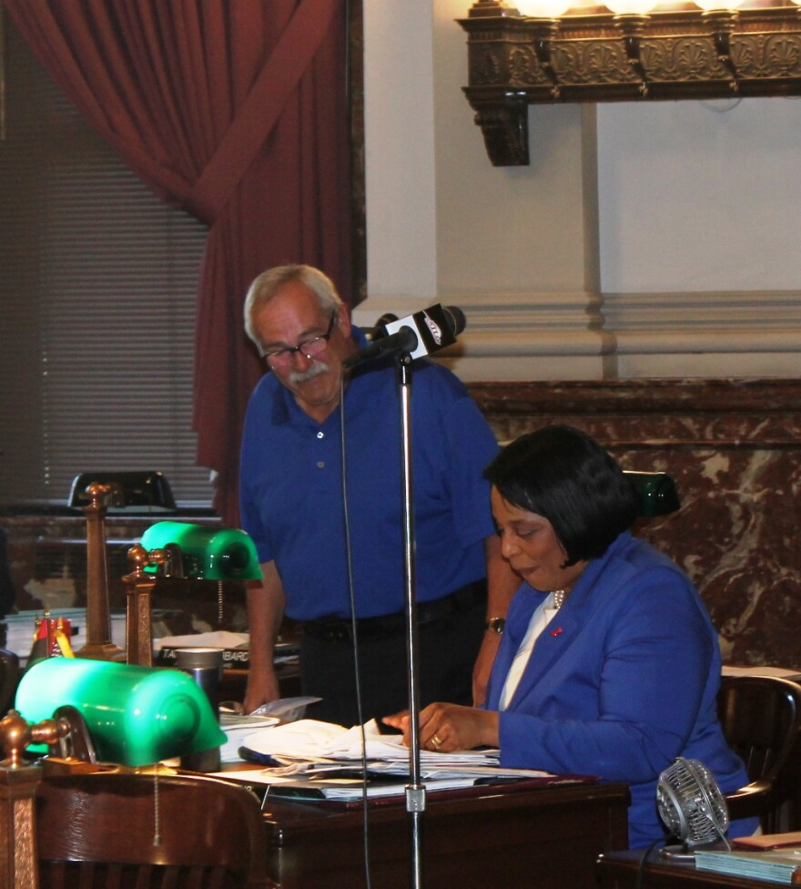 Alderman Larry Arnowitz, D-12th Ward and Alderwoman Sharon Tyus, D-1st Ward, confer during a Board of Aldermen meeting on July 7, 2017.