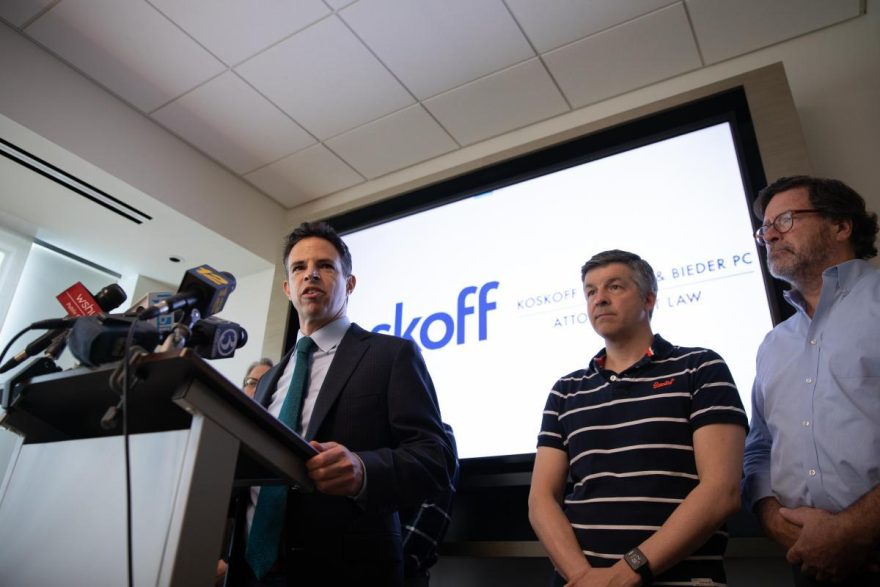 Josh Koskoff, attorney for nine families suing gun manufacturer Remington Arms Co., speaks at a 2019 press conference. Ian Hockley's son and Bill Sherlach's wife were killed in the 2012 Sandy Hook Elementary School shooting.