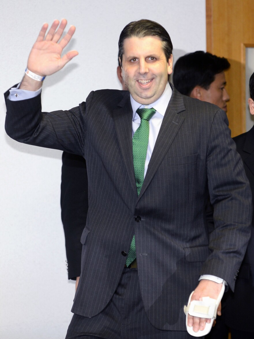 U.S. Ambassador to South Korea Mark Lippert waves as he leaves a hospital in Seoul, where he recovered from being attacked by a knife-wielding South Korean nationalist.