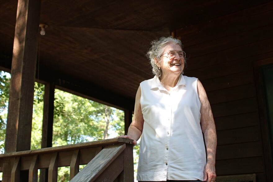 """Lulabelle Berry surveys the 600 acres she and her husband, Jimmy, own in the Ozarks near Mountain View, Ark. Berry walks laps on her porch to aid her recovery from a stroke. She says she's grateful for the drug that saved her life. """"It's been a good life,"""" she says."""