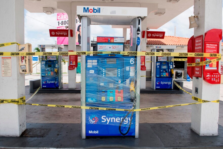 Empty pumps are surrounded by tape at a Mobil gas station in Miami on Friday.