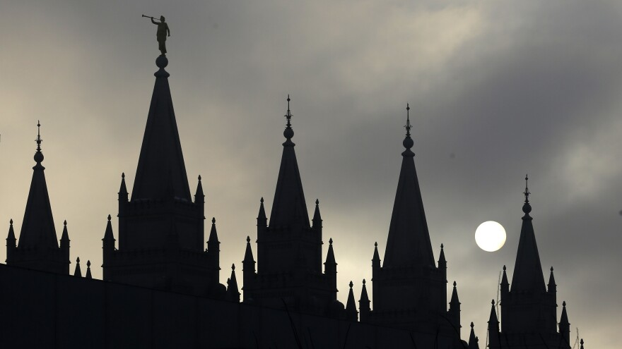 In this February 2013 photo, the statue of the angel Moroni sits atop the Salt Lake Temple, in Salt Lake City. Hundreds of Mormons have resigned their memberships in the church in protest of a new policy aimed at children of same-sex couples.