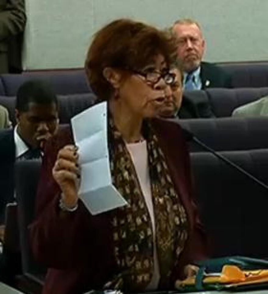 Judy Thompson, President of the Forgotten Majority, is holding up a letter of an inmate, who wrote about abuse he encountered within Florida's prison system.