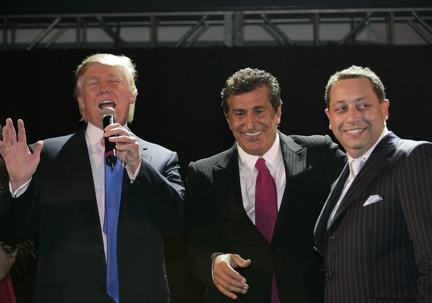 Donald Trump speaks alongside Bayrock's Tevfik Arif and Felix Sater at the Trump SoHo launch party in September 2007.