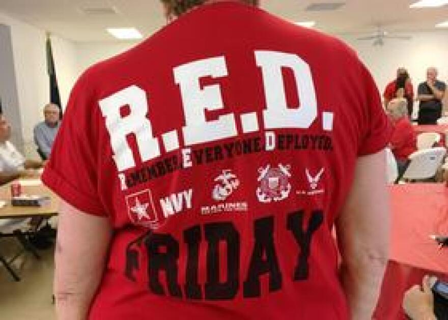 """American Legion Post 273 in Madeira Beach sells Remember Everyone Deployed t-shirts for those who want to participate in """"wear red Fridays."""""""