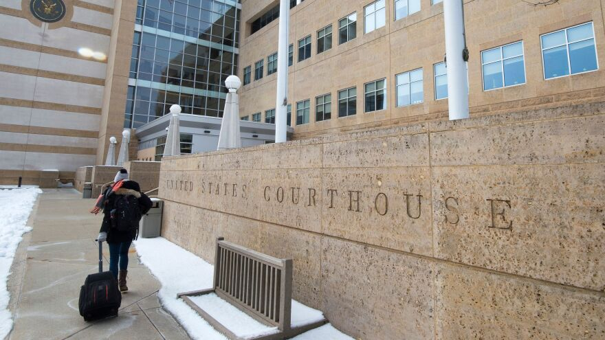 A person enters the U.S. District Court in Greenbelt, Md., on Wednesday. A judge there imposed a preliminary injunction blocking part of President Trump's new travel ban from going into effect.