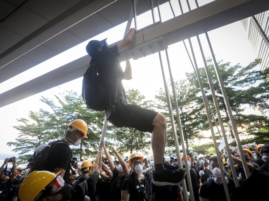 Protesters dismantled part of the metal facade at the government's headquarters in Hong Kong on Monday.