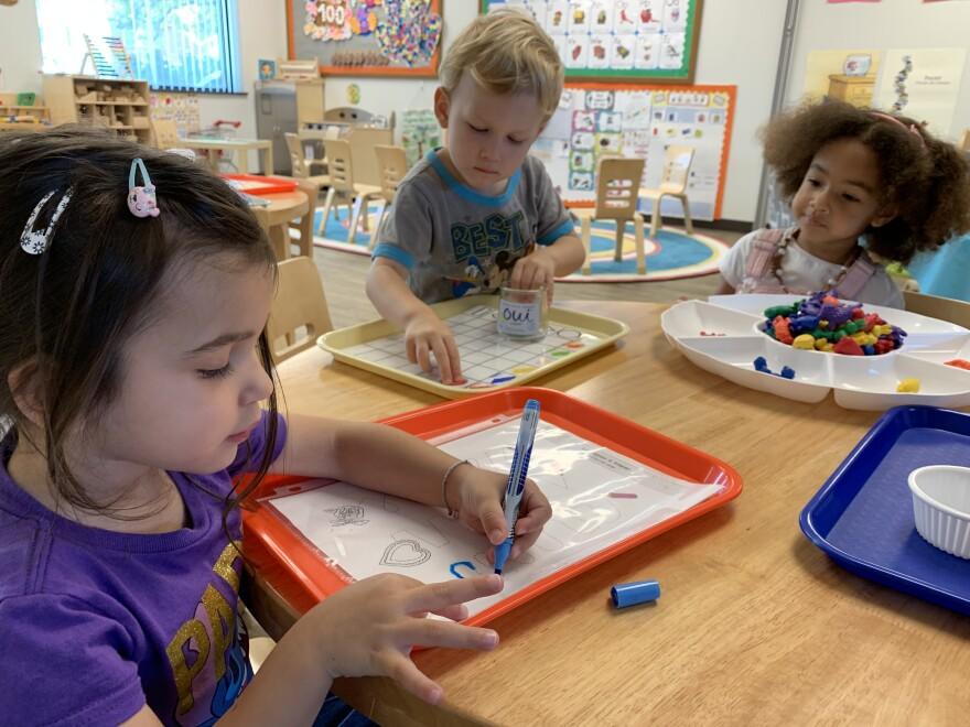 Preschool children at a table.
