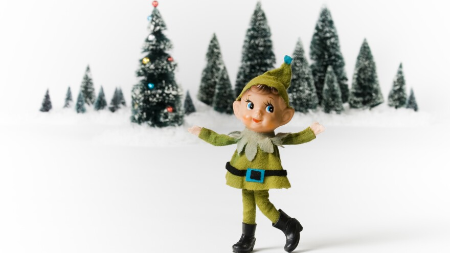 A toy elf near little trees