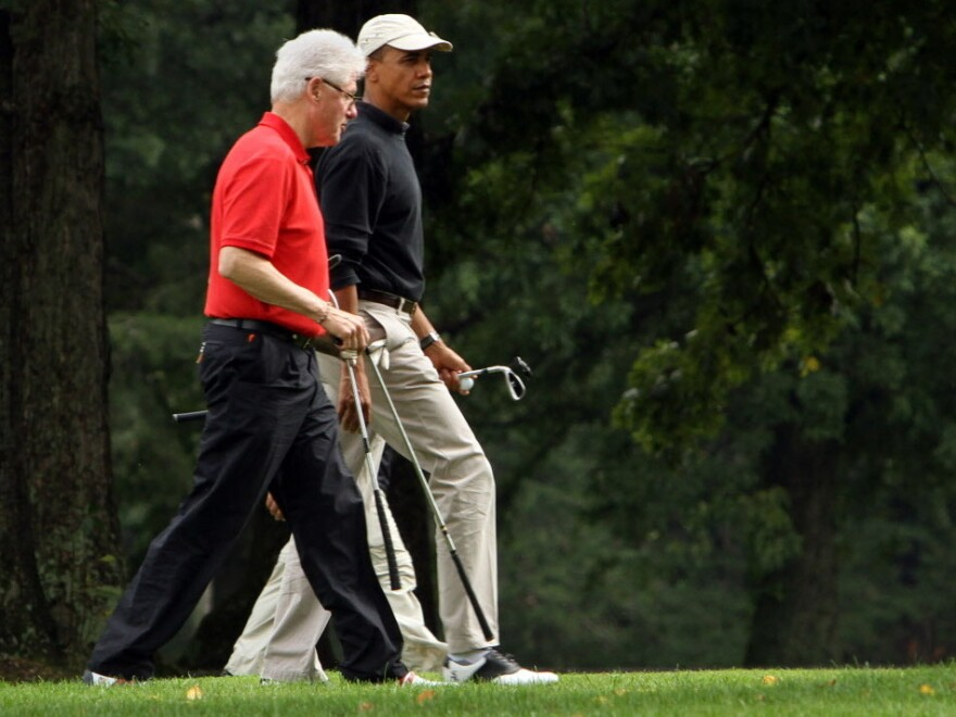 Presidents Clinton and Obama during a round of golf last September.