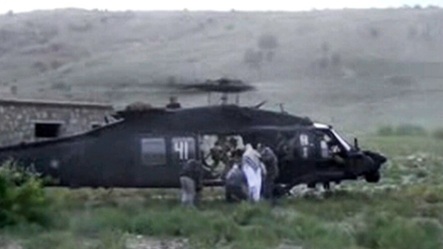 When it carried out a tense prisoner exchange in May, the Pentagon misused nearly $1 million, the Government Accountability Office says. Army Sgt. Bowe Bergdahl was taken out of captivity in Afghanistan, as seen in this image from video obtained from the Voice Of Jihad Website.