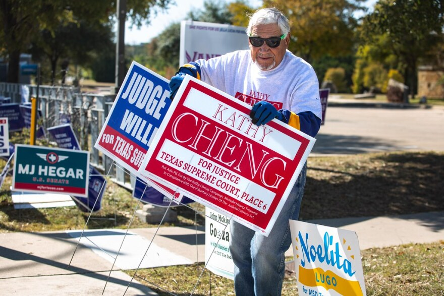Fidel Acevedo of the Progressive Hispanic Democrats removes campaign signs outside the Ruiz Branch Library the day after the election.