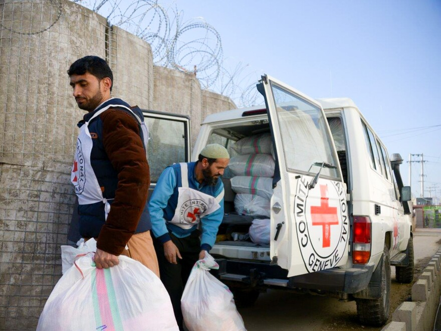 Two Red Cross workers prepare to distribute goods to detainees at a provincial prison in Afghanistan.