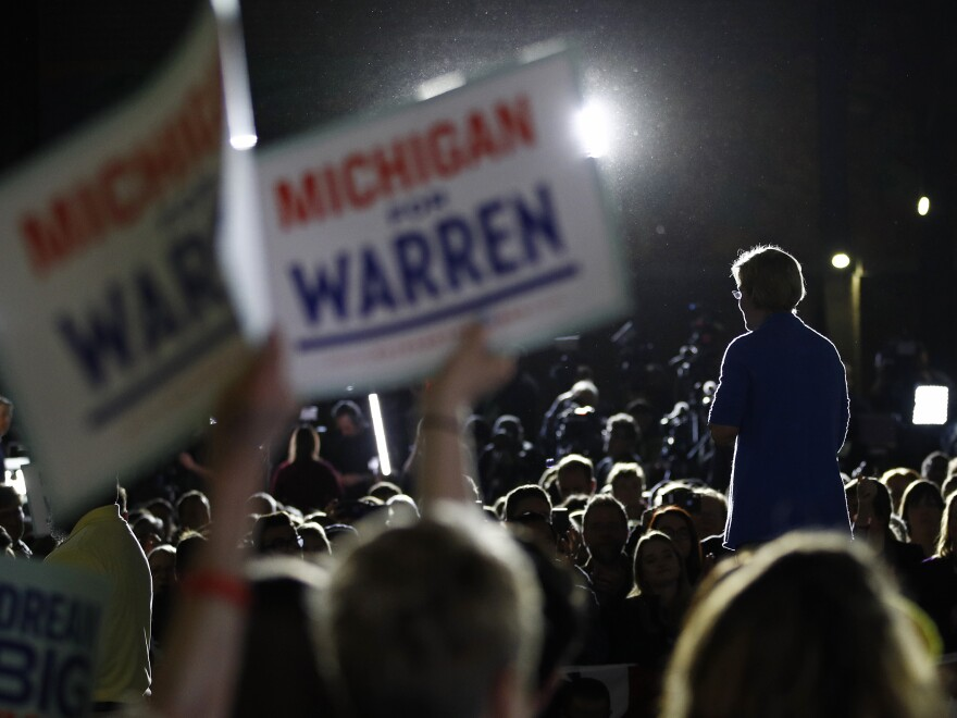 "Supporters hold up signs that read ""Michigan for Warren"" as Sen. Elizabeth Warren speaks in Detroit on Super Tuesday."