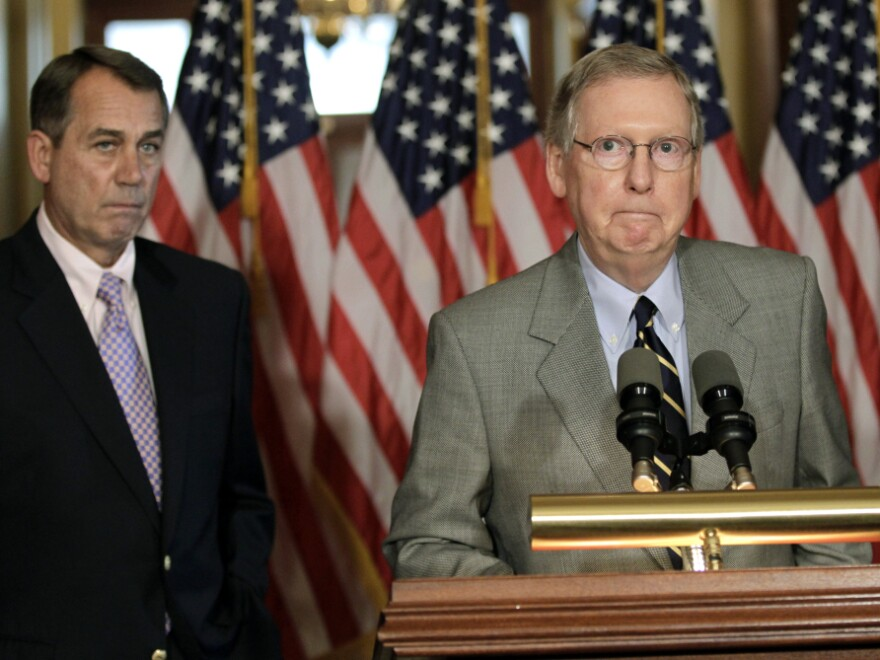 Speaker of the House John Boehner (left) and Senate Republican leader Mitch McConnell speak at a news conference as the debt crisis goes unresolved on Capitol Hill on Saturday.