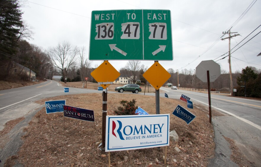 Political signs are pictured at an intersection in Manchester, New Hampshire.
