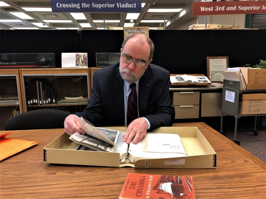 Bill Barrow combs through historical photos of the Cuyahoga River.