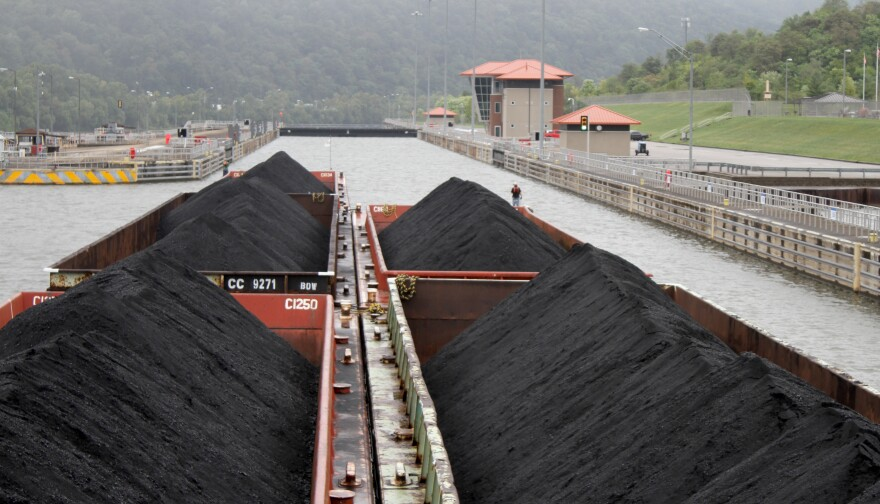 Five barges full of coal being transported along the Kanawha River in Marmet, W.Va.