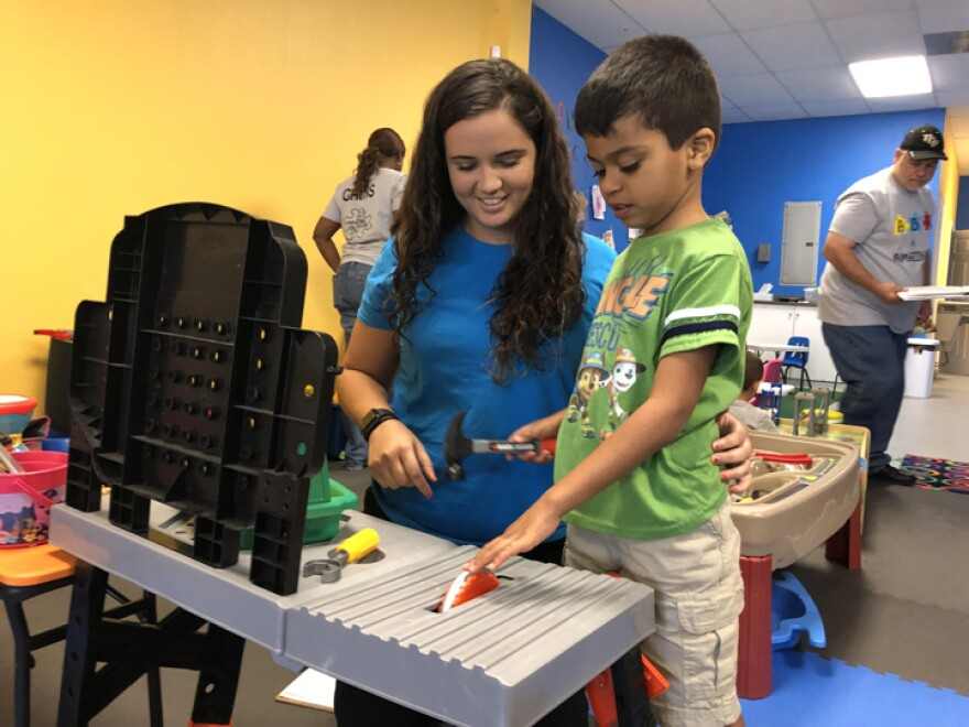 Ana Lopez Del Castillo, a registered behavior technician, works with a child at Amazing Gains Behavior Therapy Services in Orlando.