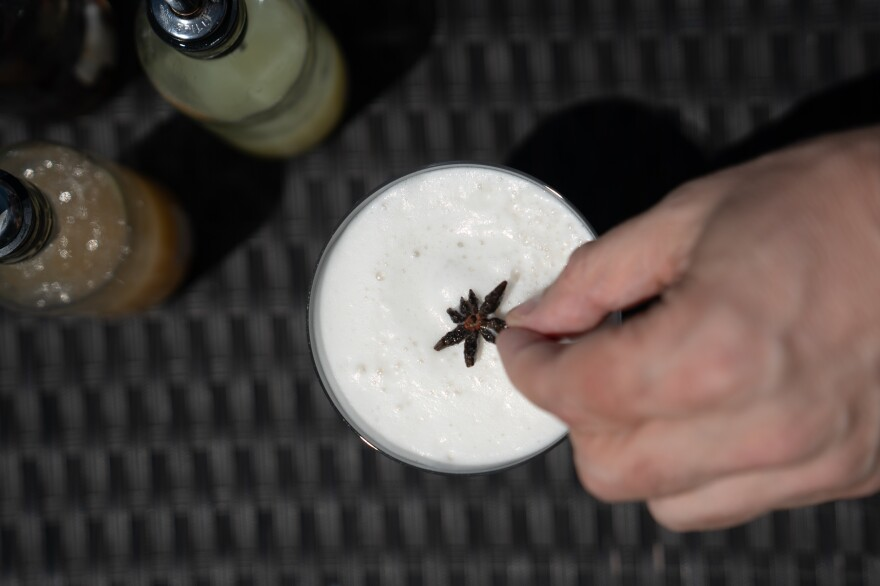Brown places a star anise on top of the Spirit-Free Lion's Tail, an alcohol-free cocktail he just made.