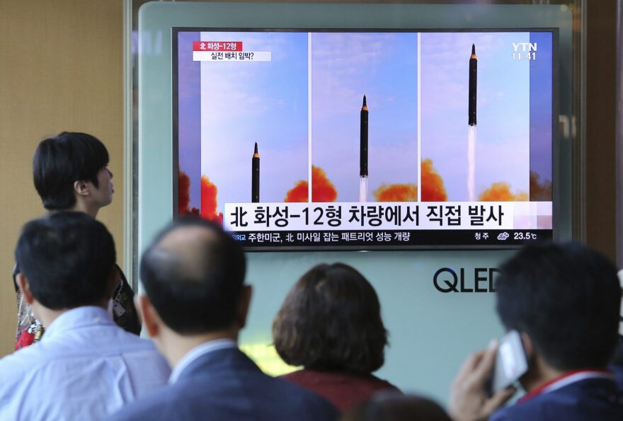 People watch a TV screen  at the Seoul Railway Station in Seoul that shows a local news program reporting about North Korea's missile launch. (Ahn Young-joon/AP)