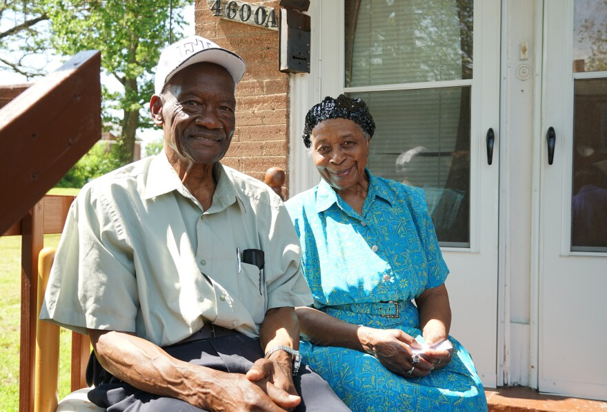 Lenton and Joannia Morris sit on the front porch of the Shelley house during Friday's dedication ceremony. The couple now owns the historic home.