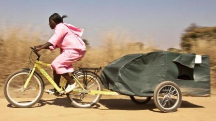 Bike ambulance driver Grace Kakyo transports a patient in northern Uganda.