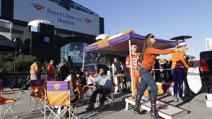 The ACC is choosing new locations for neutral-site championships because of North Carolina's controversial law known as HB2. Here, Clemson fans tailgate outside Bank of America Stadium in Charlotte, prior to last December's NCAA Atlantic Coast Conference championship college football game.