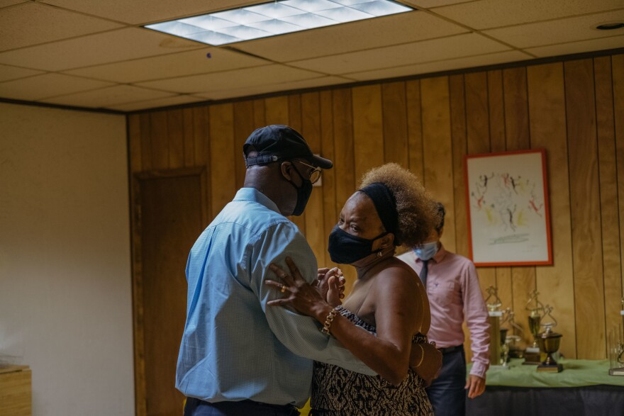 Ballroom dance instructor Richard Larocca leads a private dance lesson. For the first time in five months, Marc and Raymonde Elian attend an in-person dance class at the Arthur Murray Dance Studio in Yonkers, N.Y., in July 2020.