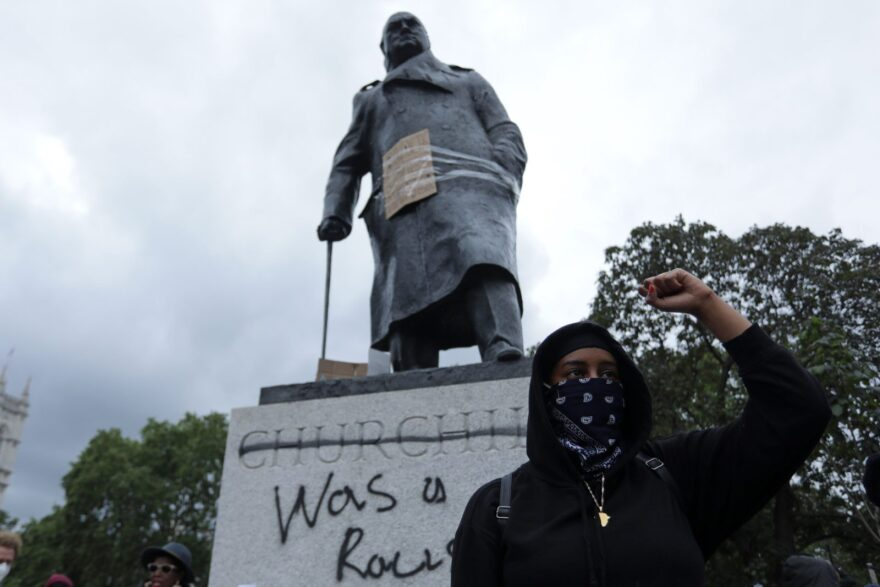 "A protester stands in front of a statue of former British prime minister Winston Churchill, with the words (Churchill) ""was a racist"" written on its base in central London after a demonstration outside the US Embassy. The protest was organized to show solidarity with the Black Lives Matter movement."