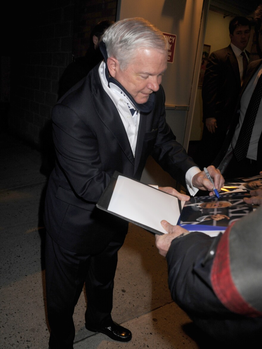 Former Defense Secretary Robert Gates promotes his new book during a visit to 'The Daily Show With Jon Stewart' on Jan. 15 in New York. In the book, Gates criticizes both his former boss, President Obama, and Vice President Joe Biden.
