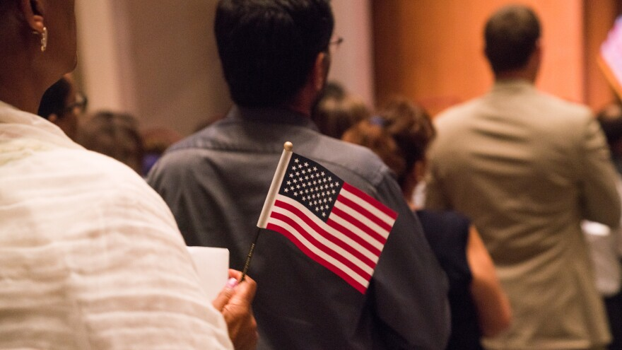 Newly sworn-in U.S. citizens gathered for a naturalization ceremony at the Rachel M. Schlesinger Concert Hall and Arts Center in Alexandria, Va., in August.