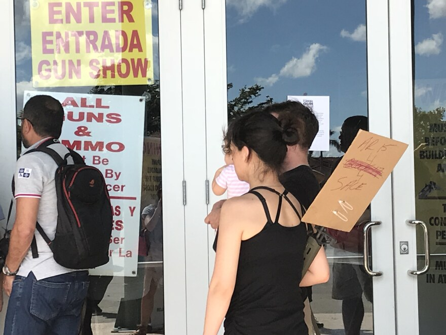 "One family entering the Miami Gun Show on Saturday simply held a sign that read ""AR-15 4 sale."""