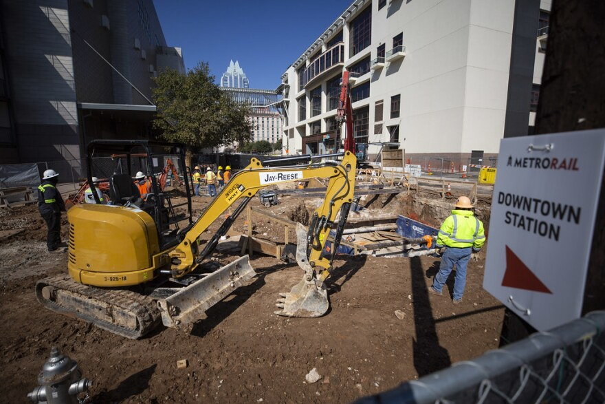 A construction crew works on the site of the future Capital Metro downtown station.
