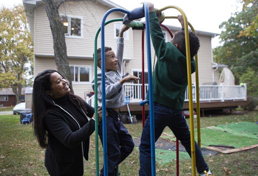 Mercedes and her two sons Lucas, 7, (center) and Sebastian, 5, (right) play in their backyard. Mercedes' husband is a guard at New York's Rikers Island jail. Her sons struggled with home schooling, so in late August, with some trepidation, she gave up her corporate job.