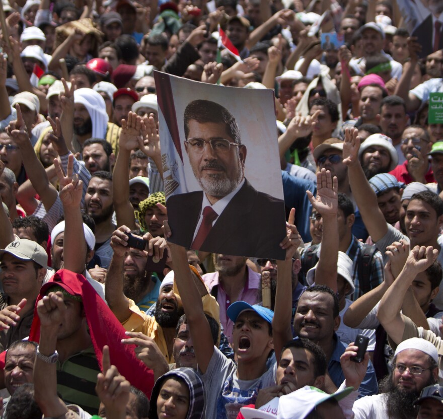 Supporters of the Muslim Brotherhood hold a picture of deposed President Mohammed Morsi during a rally outside Cairo's Rabaa al-Adawiya mosque on Friday.