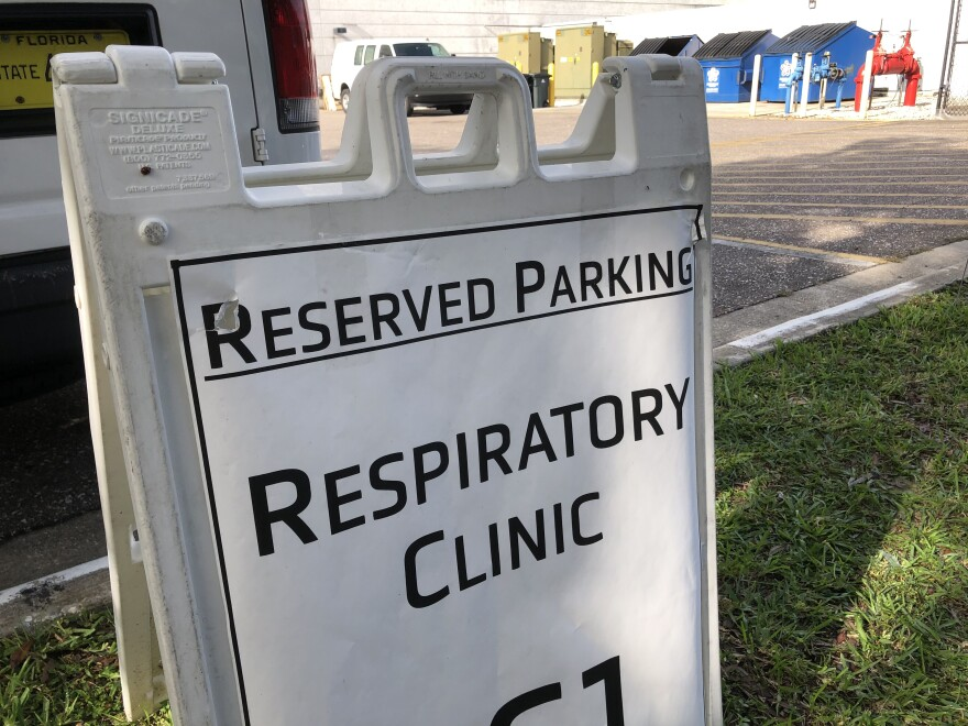 A sign says reserved parking respiratory clinic.