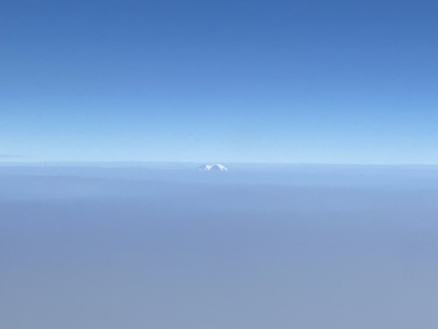 A mountain peak pokes out from a thick blanket of smoke covering much of the West Coast.