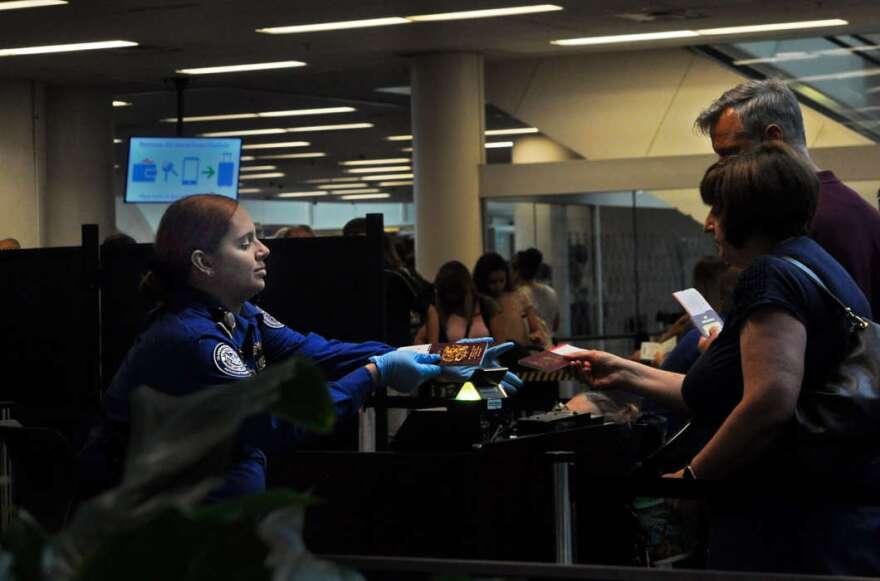 Agents at Orlando International Airport/ Isaac Babcock / WMFE