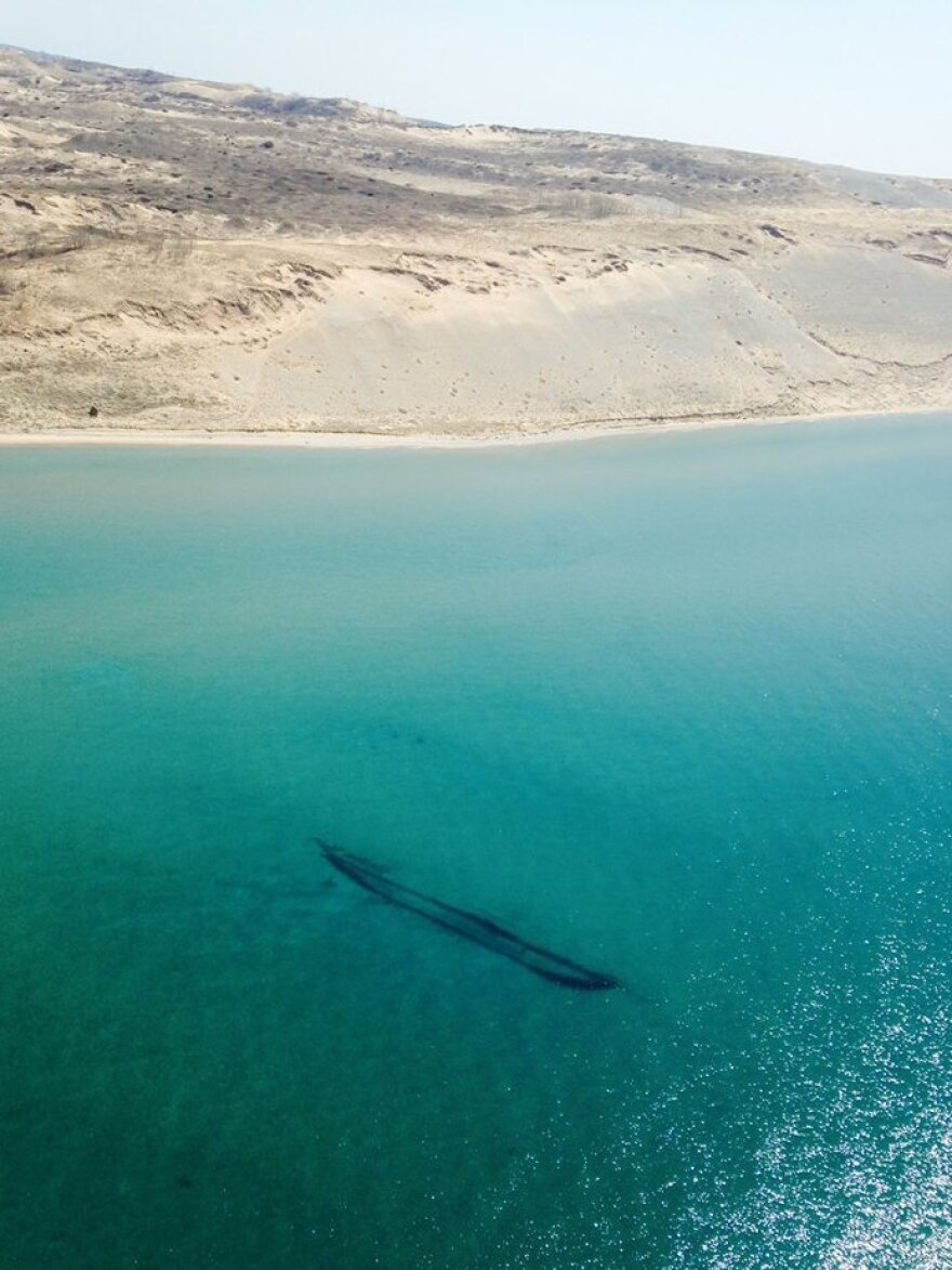 The Coast Guard says this shipwreck is the 121-foot brig James McBride, which ran aground in a storm in 1857 near Sleeping Bear Point. It rests in 5 to 15 feet of water, according to the Michigan Preserves website.