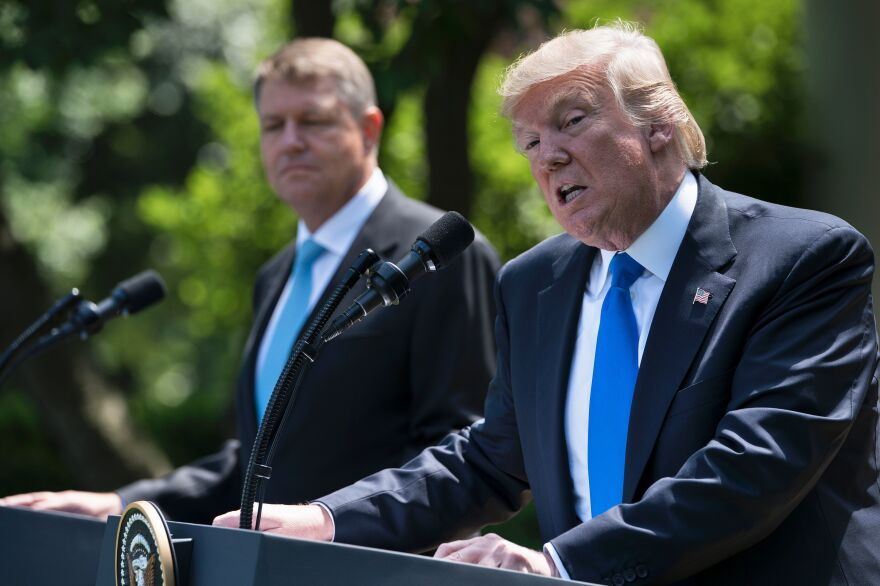 President Trump and Romania's President Klaus Iohannis at a press conference in the Rose Garden of the White House on Friday.