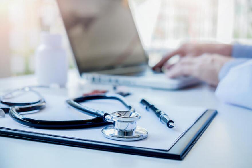 stethoscope_and_doctor_on_laptop_computer_..._istock.jpg