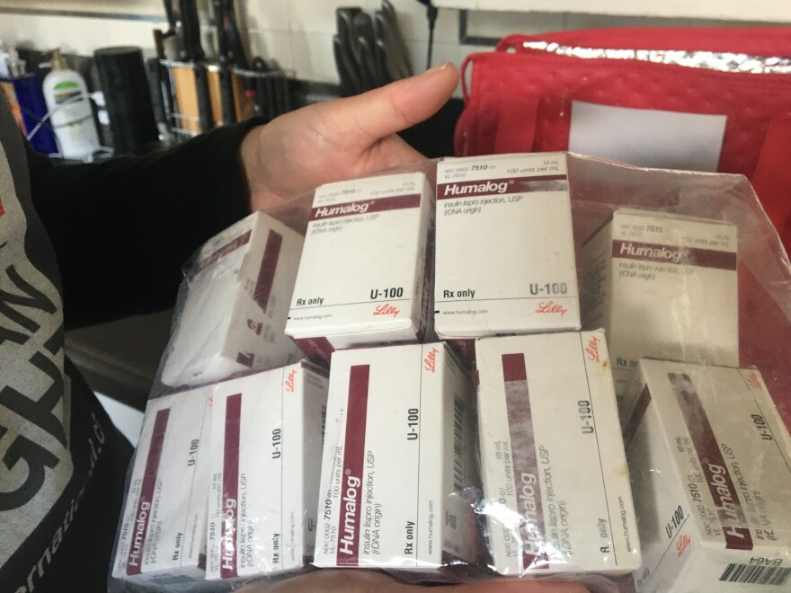Photo of insulin boxes.