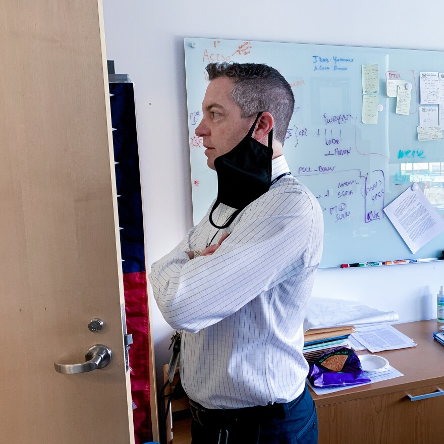 Christopher Mores in his office at the Milken Institute School of Public Health at George Washington University.