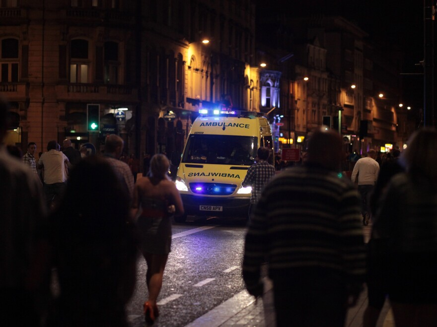 An ambulance makes its way through revelers in Cardiff city center in Wales in 2010. New measures in the city have reduced injuries caused by violence.