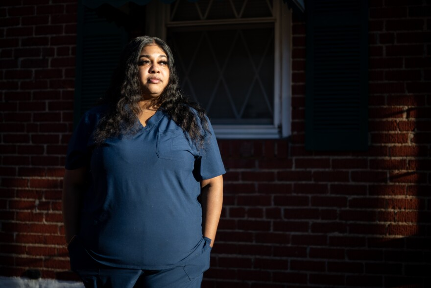 Ashley Mosley, a Certified Nursing Assistant, advocates for hazard pay for essential workers because of their increased risk of contracting the coronavirus.