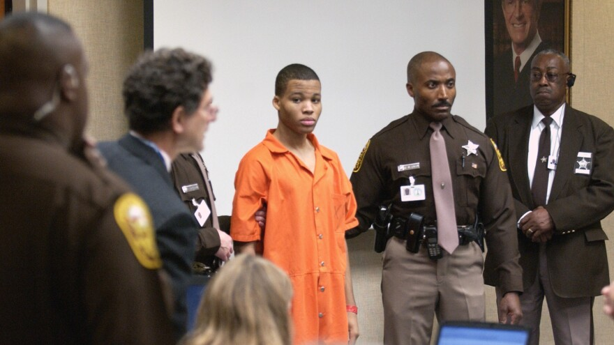 Lee Boyd Malvo (center) enters a courtroom in Virginia Beach, Va., in 2003. Some 15 years later, at the age of 33, Malvo has been granted another sentencing hearing.